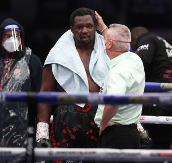 HANDOUT PICTURE COMPLIMENTS OF MATCHROOM BOXING Dillian Whyte vs Alexander Povetkin, WBC Diamond Belt Title fight. 22 August 2020 Picture By Mark Robinson. Ref consoles Dillian Whyte dejected after the conclusion.