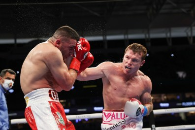 February 27, 2021; Miami, Florida; Saul Alvarez and Avni Yildirim during their WBA, WBC and Ring Magazine super middleweight championship bout at the Hard Rock Stadium in Miami, FL. Mandatory Credit: Ed Mulholland/Matchroom.
