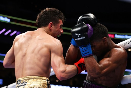 March 13, 2021; Dallas, TX; Raymond Ford vs Aaron Perez during Estrada vs Gonzalez 2 fight night at the at the American Airlines Center in Dallas, TX. Mandatory Credit: Ed Mulholland/Matchroom.