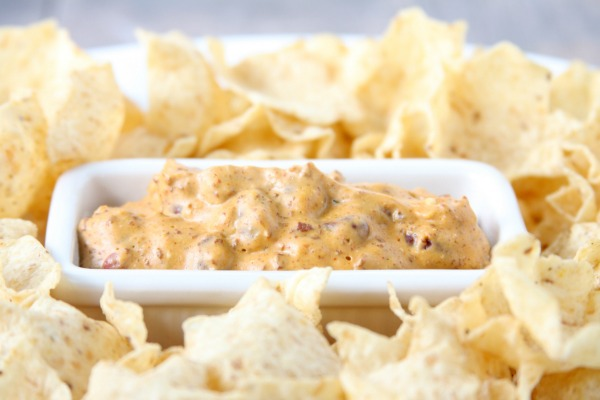 Creamy Bean Dip is perfect for game day, or even an easy appetizer! A simple, delicious recipe with only 4 ingredients!   Chili Cheese Dip   Football Recipe
