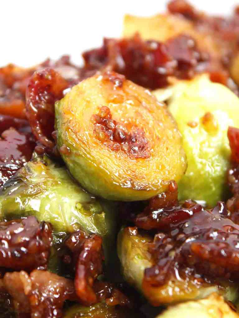 Close up of half of a sprout glazed with honey an mustard.