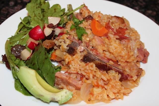 Rice with smoked pork chops (locrio de chuleta ahumada)