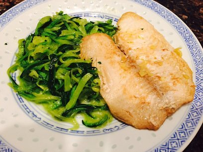 Zucchini noodles with fish fillet in ginger sauce