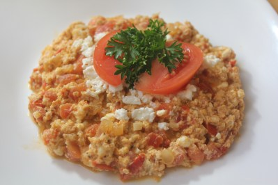 Eggs scrambled with tomatoes and feta cheese.