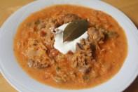 Transylvanian pork & sauerkraut stew topped with a hefty spoonful of sour cream.