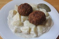 Potato stew served with Hungarian meatballs.