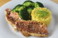 Pan-seared red snapper filets served with saffron rice and broccoli, drizzled with tarragon aioli.