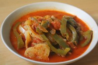 A stew of chopped paprika-spiced bell peppers with tomatoes and onions.