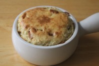 Cheese soufflé filled with apple chunks.