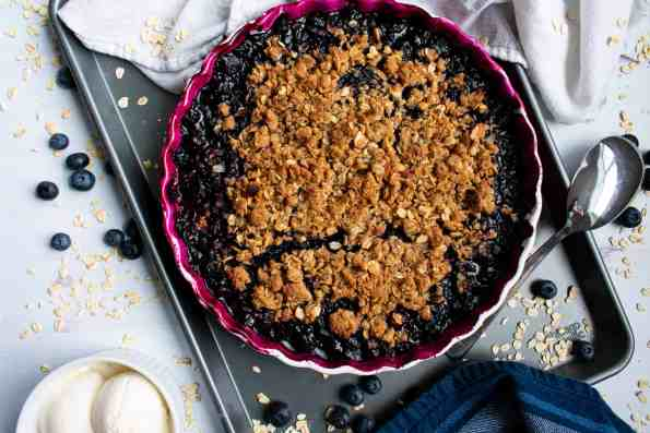 blueberry crumble in pie dish on tray