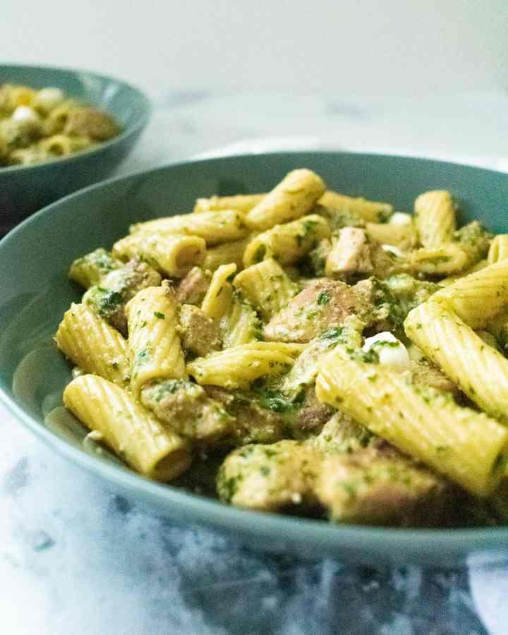pesto pasta on gray plate