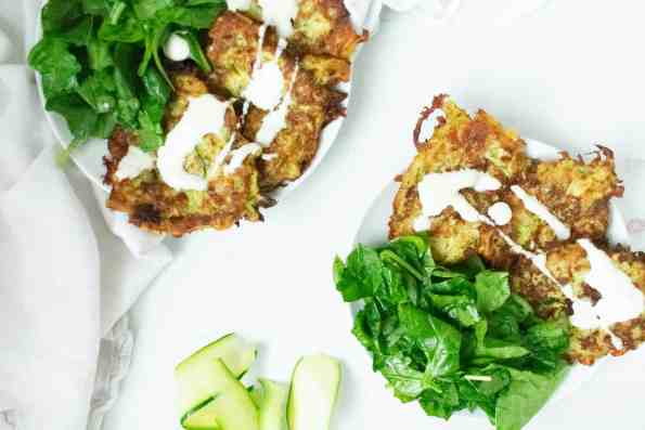 zucchini fritters on white plate