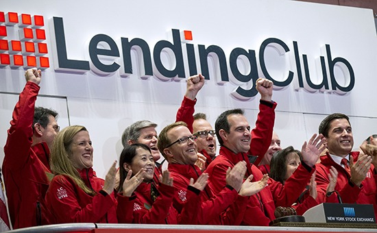 Laplanche, Founder and CEO of Lending Club, celebrates with company executives ring the opening bell during their IPO at the New York Stock Exchange