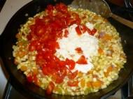 Add tomatoes, garlic and corn milk.