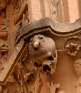 La Rana - detail of the frog on top of a skull on the carvings in Sandstone on the facade of the University of Salamanca