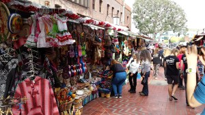 Street in LA with stalls to the left selling hispanic products