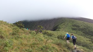 cloud line on Volcan Concepcion.  trekkers battling against the wind.