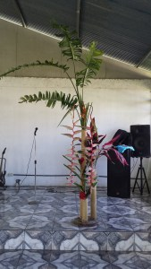 Flower display in the church, banana leaves and flower and other red flowers
