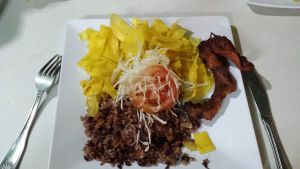 Gallo Pinto, a traditional Nicaraguan meal, plantain chips with rice and red beans