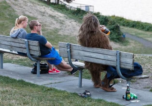 Hairy monster on park bench