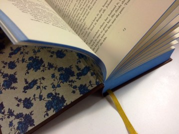 They've thought of everything with this book - the inner lining is a similar pattern to the wallpaper in the house on the cover.