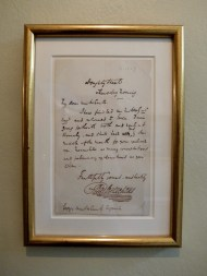 A letter to an estate agent from Dickens which is on display in the hallway.