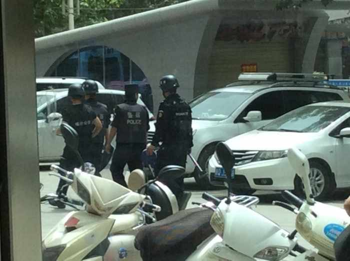 Police patrolling the streets in Urumqi