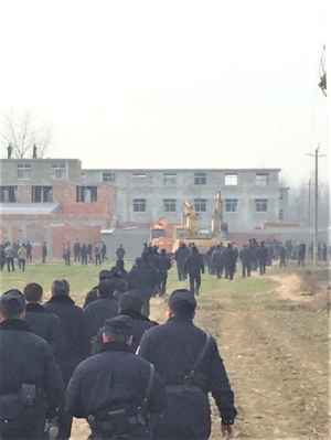 The police fully armed and three excavating machines are destroying a church in China