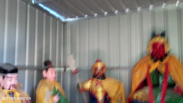 The Buddhists in the temple were taken away and put in a makeshift shed.