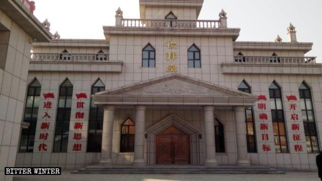 Propaganda slogans and flags on the outer walls of a Zhen'an district church.