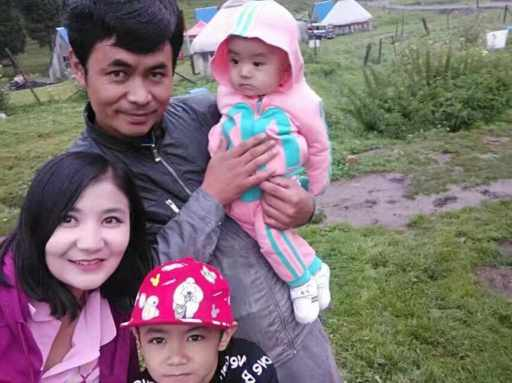 Bahargul in happier times with children and husband Niyaz Weli, who has also disappeared.