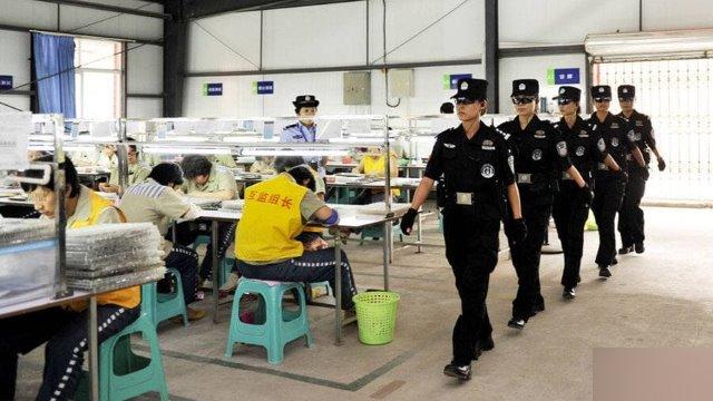 Special police officers patrolling female prison workshops.