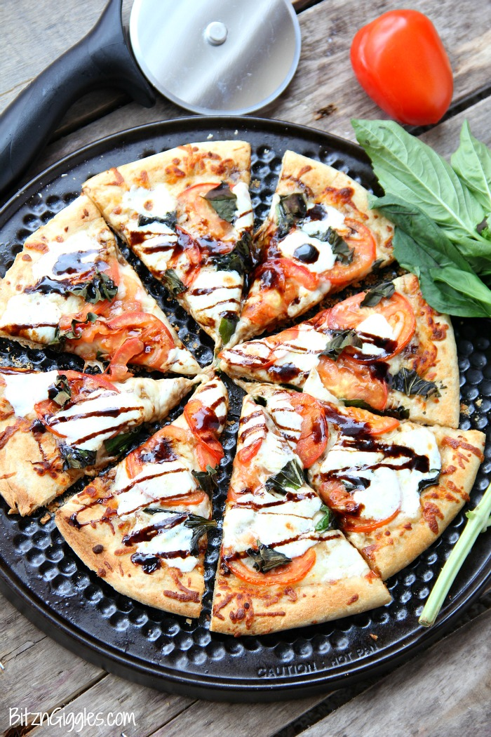 Caprese Pizza - Fresh tomatoes, basil, mozzarella and a sweet balsamic glaze makes this quite possibly the best pizza on the planet!