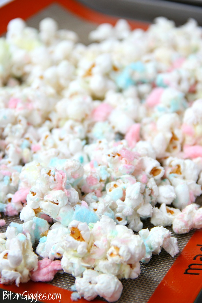 Cotton Candy Popcorn - Candy coated popcorn recipe with sprinkles and real cotton candy pieces!