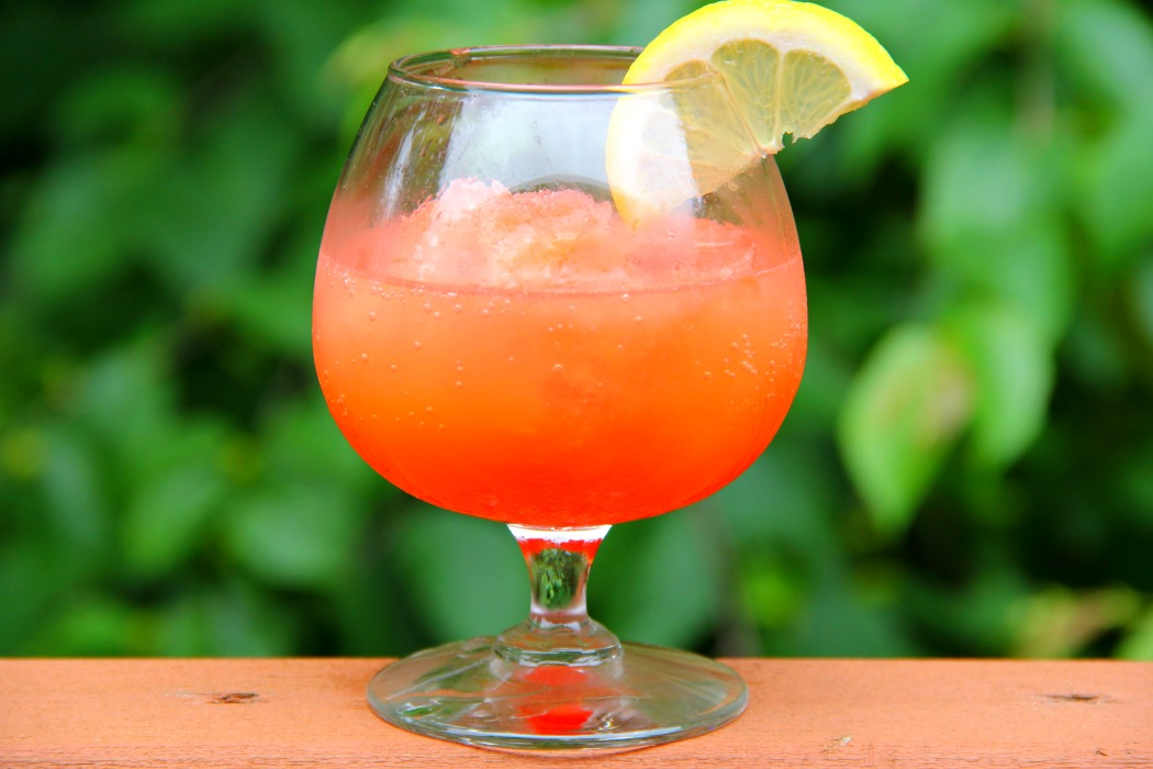 Pink Flamingo Vodka Slush - A refreshing and flavorful slushy drink perfect for parties and BBQs!