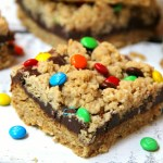 M&M Chocolate Oatmeal Bars - Chewy oatmeal bars with a chocolaty fudge layer, sprinkled with M&Ms.