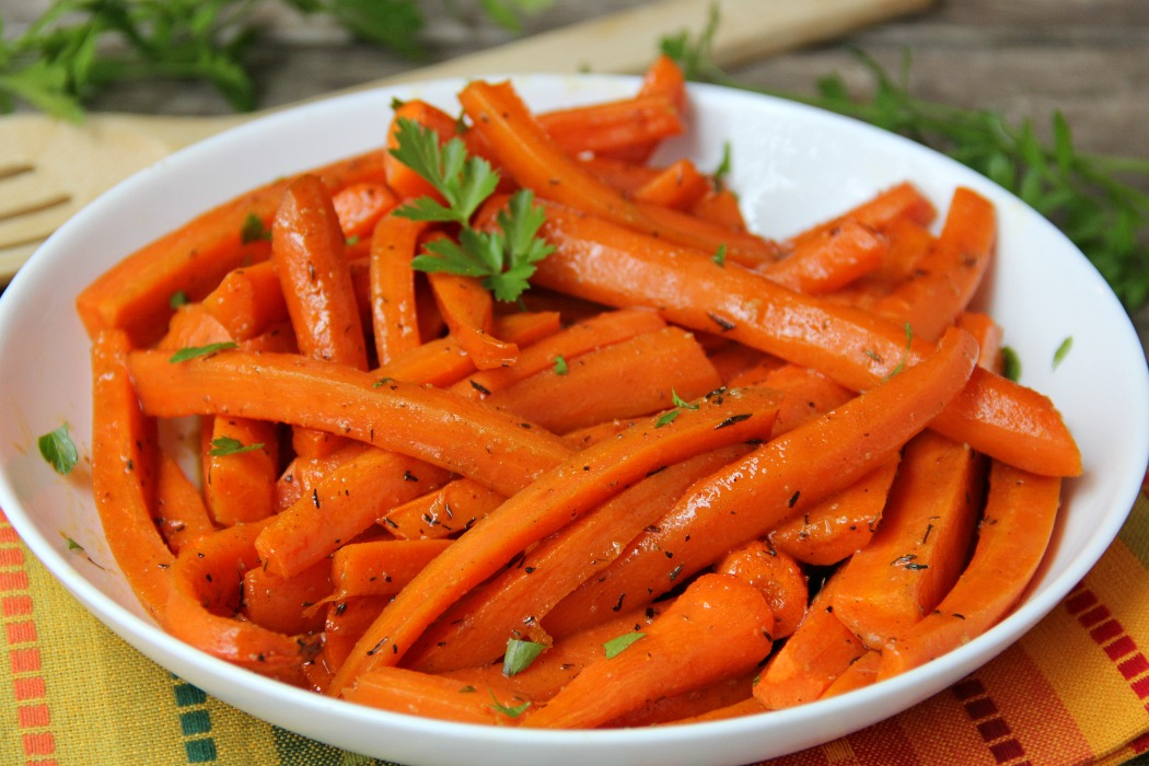 Maple Dijon Glazed Carrots - Sweet, roasted carrots with a delicious maple dijon glaze! Perfect for the holidays!