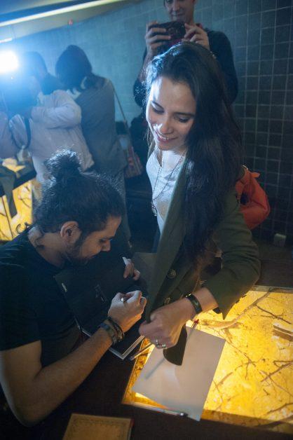Zohaib Kazi signing a book for Zoe Viccaji