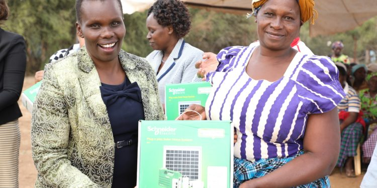 Compassion International team led by Linet Ochieng, Senior Manager Business Support demonstrate to the beneficiaries how to use the Homaya Solar Lighting Solution in one of the homes in Sultan Hamud - Bizna Kenya