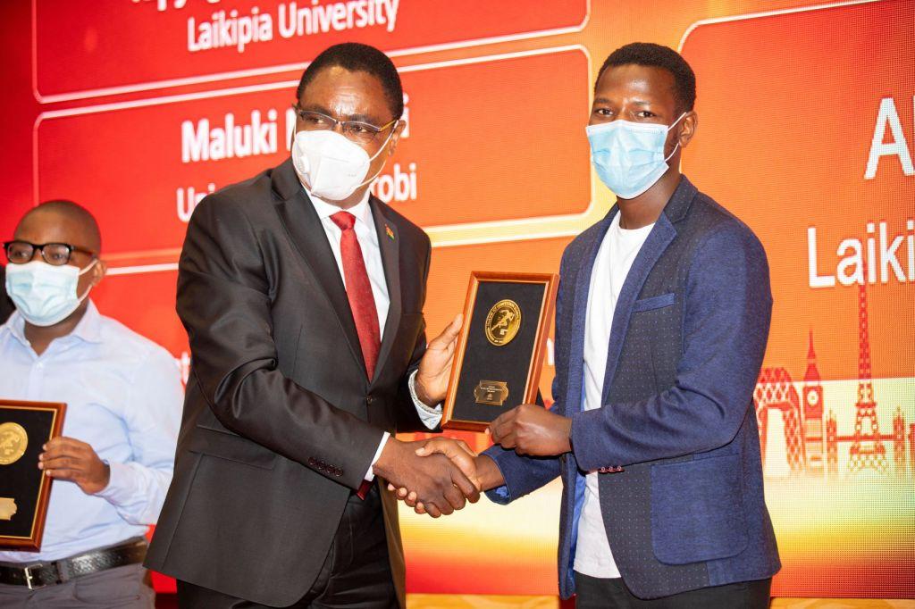 Amb Nabukwesi giving an award - Global ICT Competition - Bizna Kenya