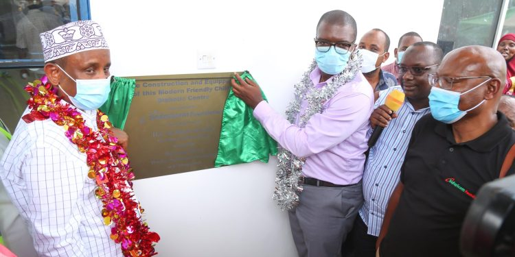 Safaricom Foundation Trustee, Barack Odero (right) and Garissa Governor H.E Alo Bunow Korane unveil the children's diabetes management centre at the Garissa Referral Hospital constructed and equipped by the Safaricom Foundation - Bizna Kenya