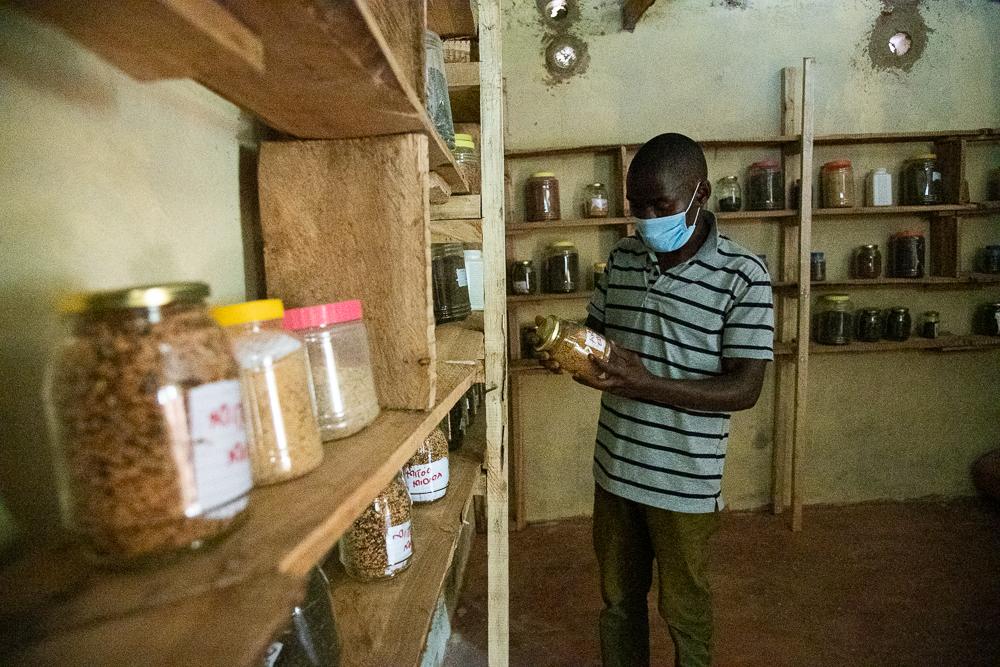 Evans Ochuto shows the diverse seeds at the seed bank at Vihiga - Bizna Kenya