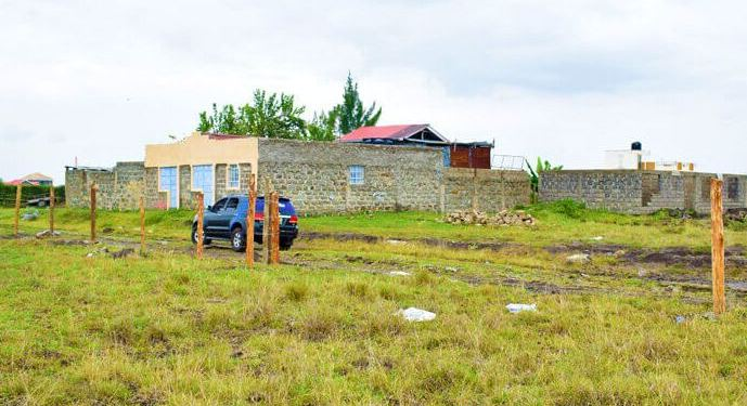 owning land in kiambu county
