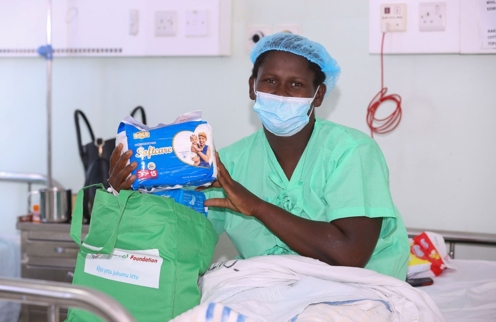 Joy Kamau, a new mother after receiving a Mama Pack during Safaricom Foundation's handover of a Maternal HDU and Newborn unit in KNH Othaya, Nyeri County - Bizna Kenya