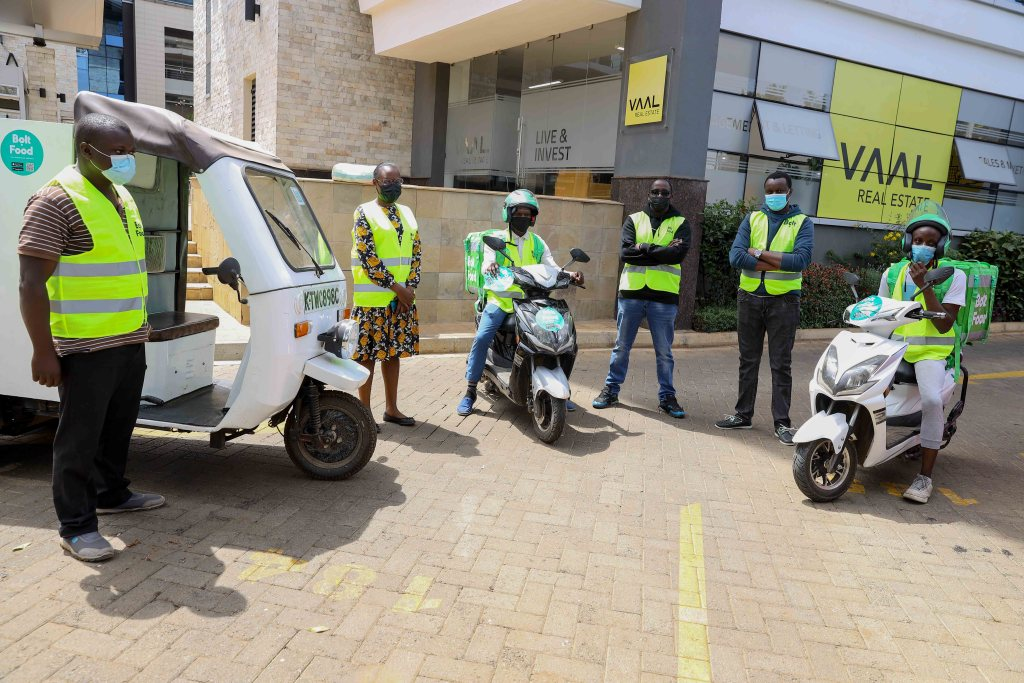 Bolt Food representatives and Bolt Food couriers display the e-bikes and e-tuk tuk that have been introduced by Bolt as the company seeks to expand its green transport options in Kenya - Bizna Kenya