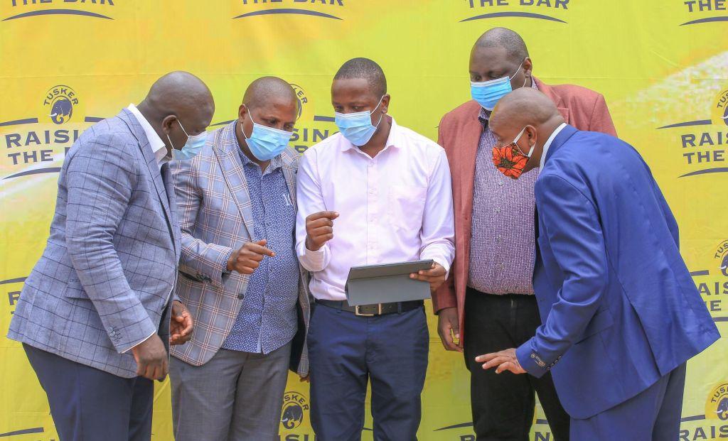 John Wambugu - Raising the Bar Program Manager demonstrates the registration process of the program - Bizna Kenya