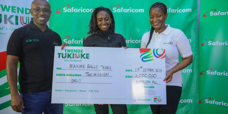 Rally Driver Maxine Wahome (R) and her co-driver Linet Ayuko (L) hold a dummy cheque during Safaricom Cheque Handover at Safaricom Headquarters - Bizna Kenya