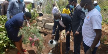 Murang'a County Programs Coordinator Joseph Ngugi and other County officials planting a tree during the inauguration of Maragua Ridge Water and Food Security Program - Bizna Kenya