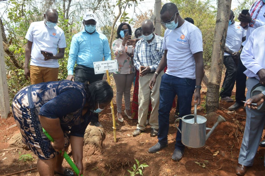 Bethel Network Director, Mary Ndungu planting a a tree during the inauguration Ceremony of The Maragua Ridge Water and Food Security Program - Bizna Kenya
