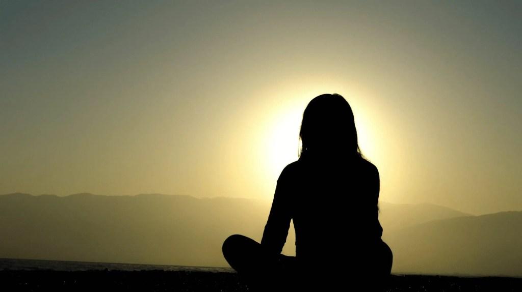 woman meditating in peace